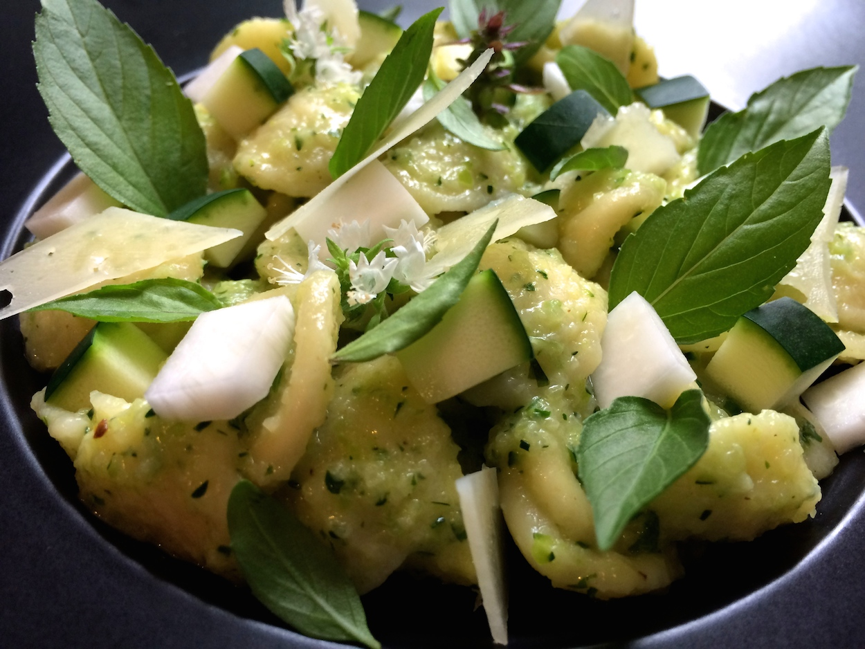... the diced zucchini and serve with pecorino shavings and basil leaves