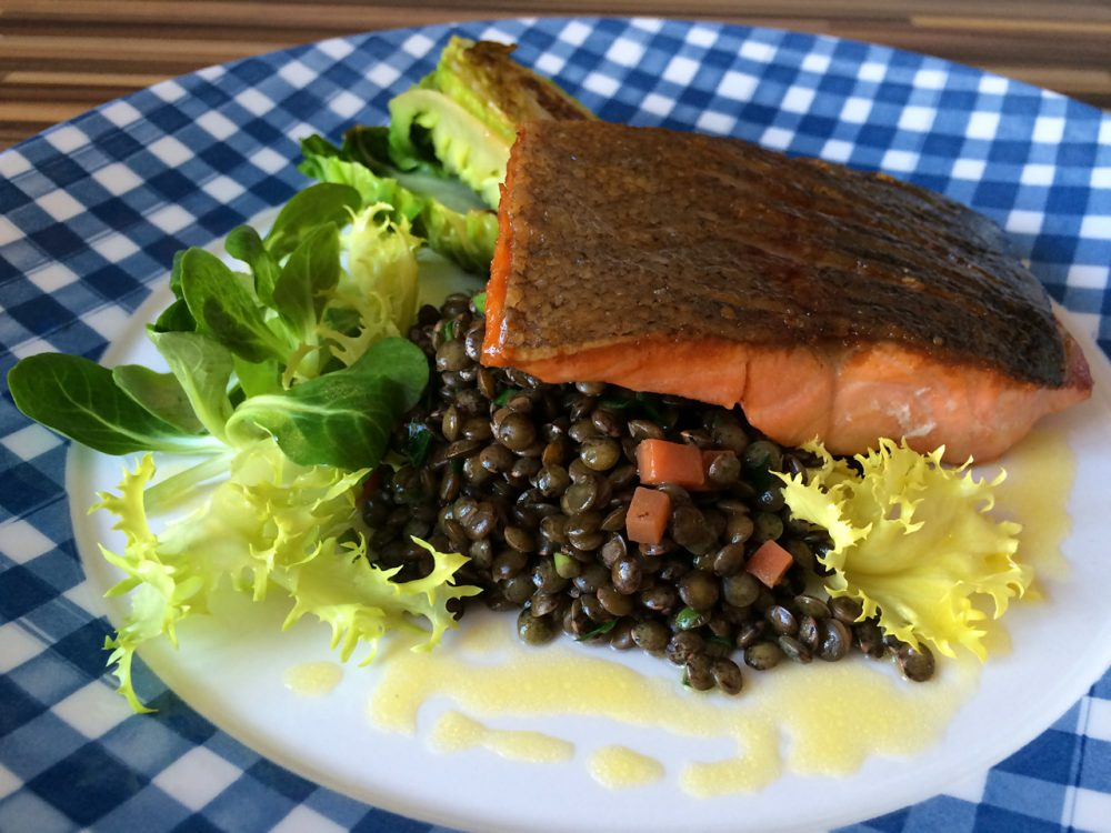 Pan-fried fillet of sea trout, French green lentils and lime dressing