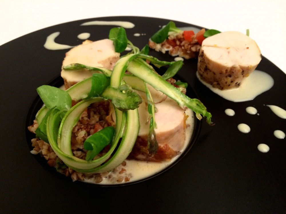Poached chicken breast with buckwheat, asparagus and white wine sauce