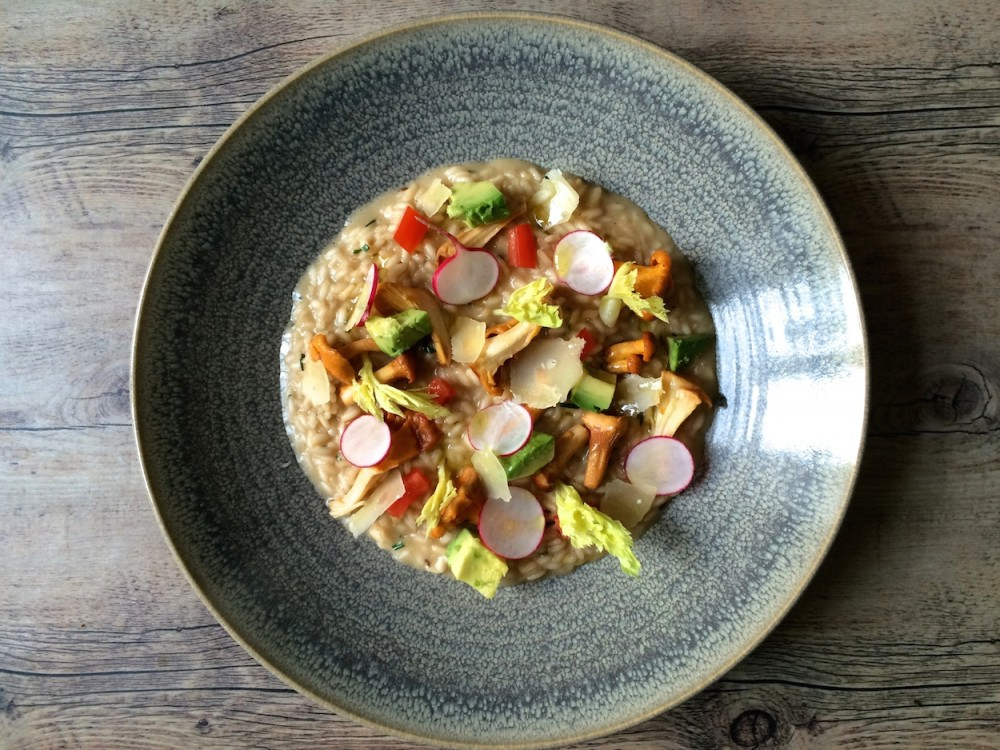 Chanterelle risotto with avocado and veggies