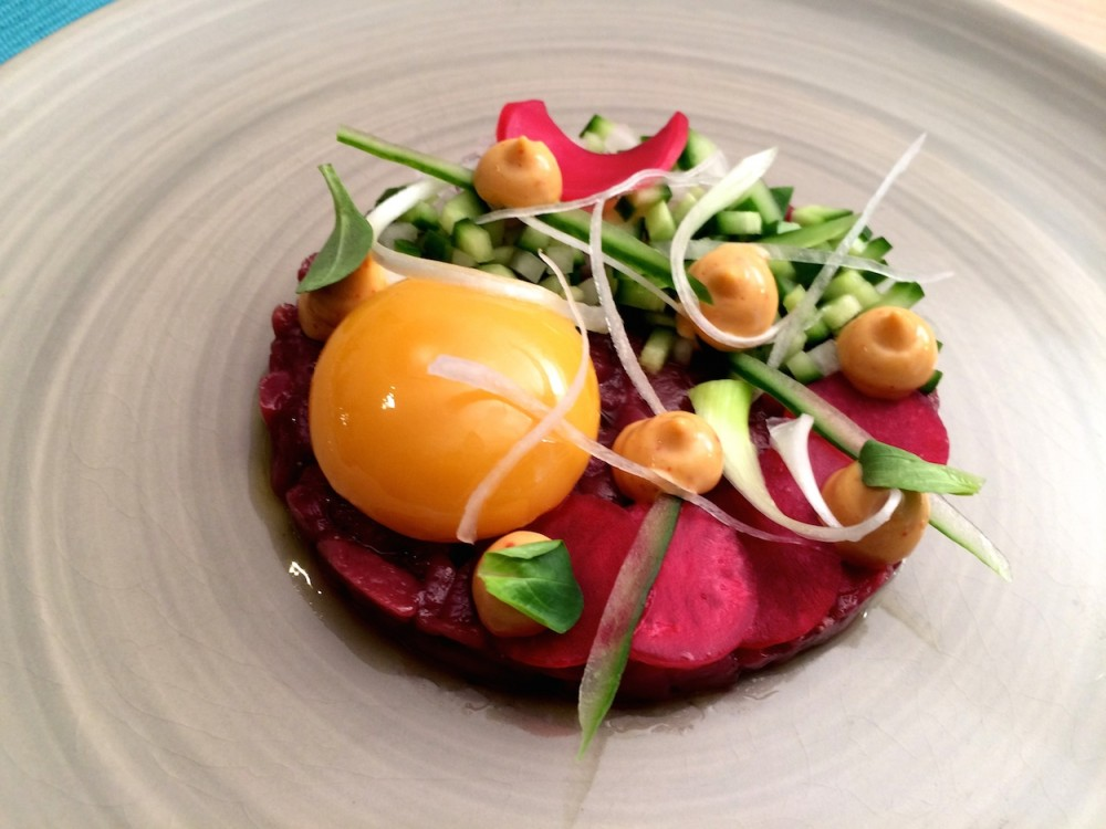 Roe deer tartare, smoked egg yolk, cucumber and radishes