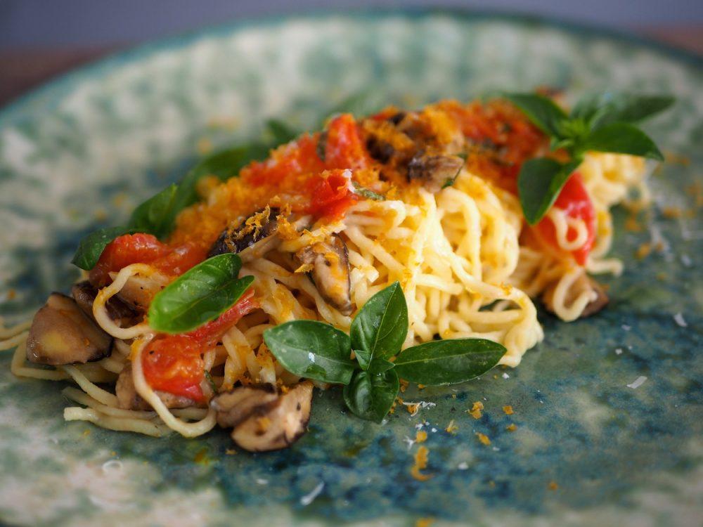 Spaghetti with porcini mushrooms, tomatoes and bottarga