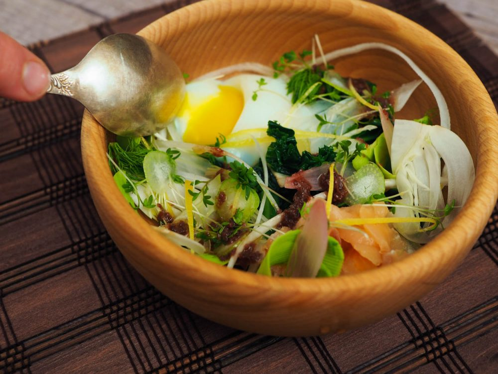 Salad with sous vide egg, olive vinaigrette
