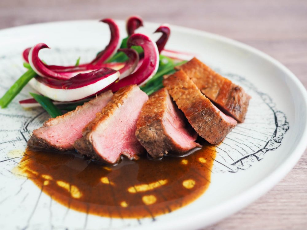 Sous vide duck breasts, coffee, radicchio di Treviso, green beans and fresh spinach