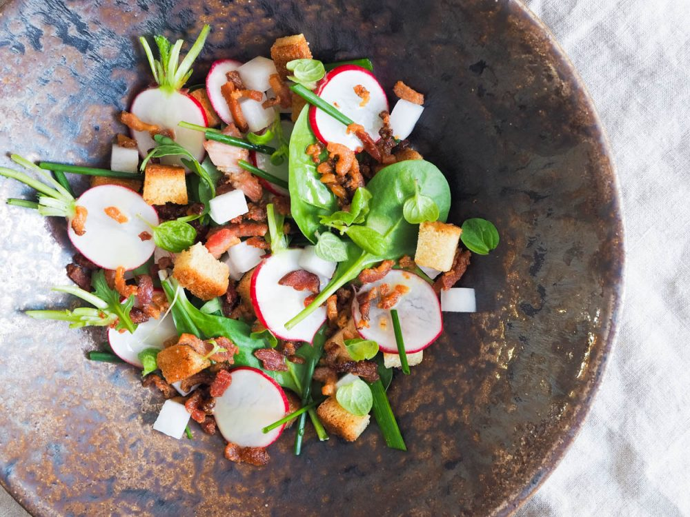 Radish salad with bacon and croutons