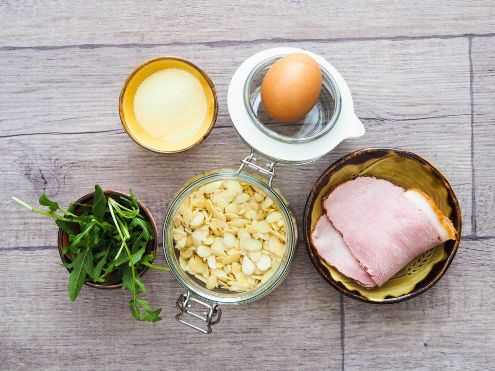 Tagliatelle with rocket pesto, almonds and ham
